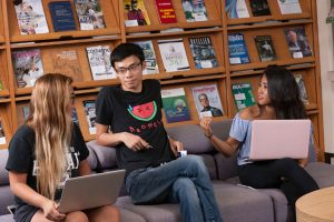 image of 3 students at the Sunset Reference Center at University of Hawaii at Manoa
