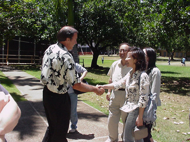 image of EDIT student shaking faculty memberʻs hand