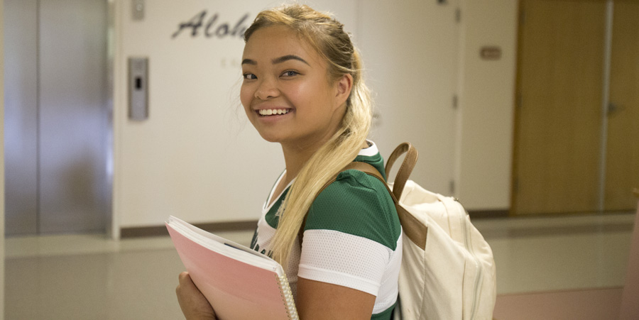 image of a female student in a hallway