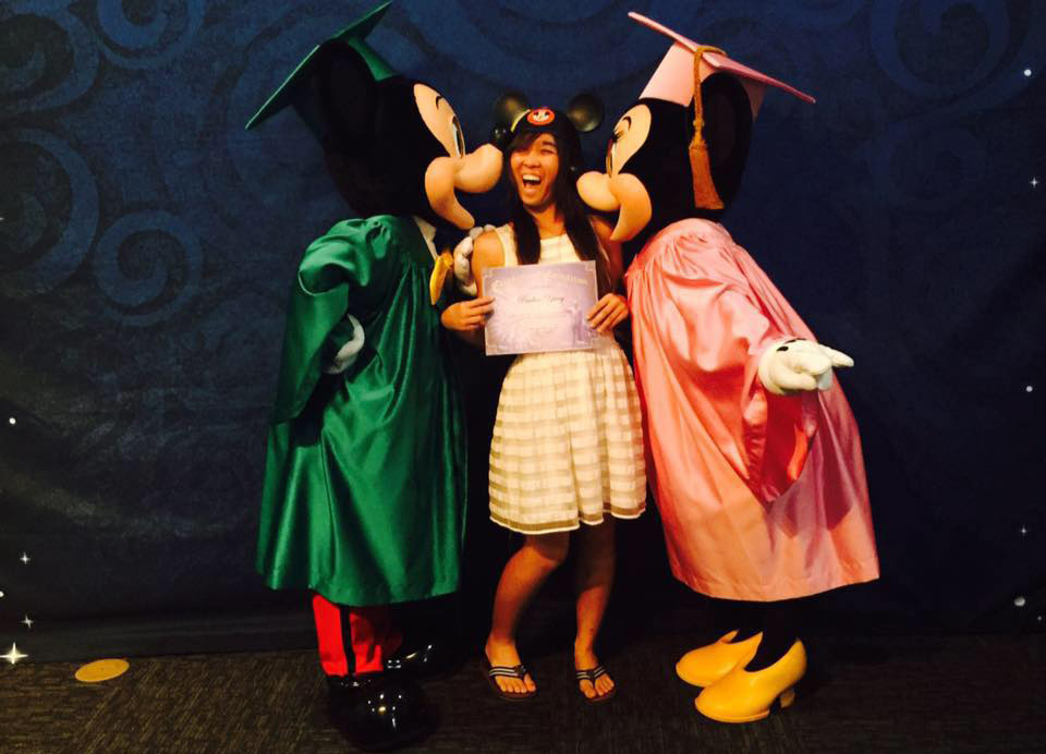 Image of female student with Micky and Minnie Mouse